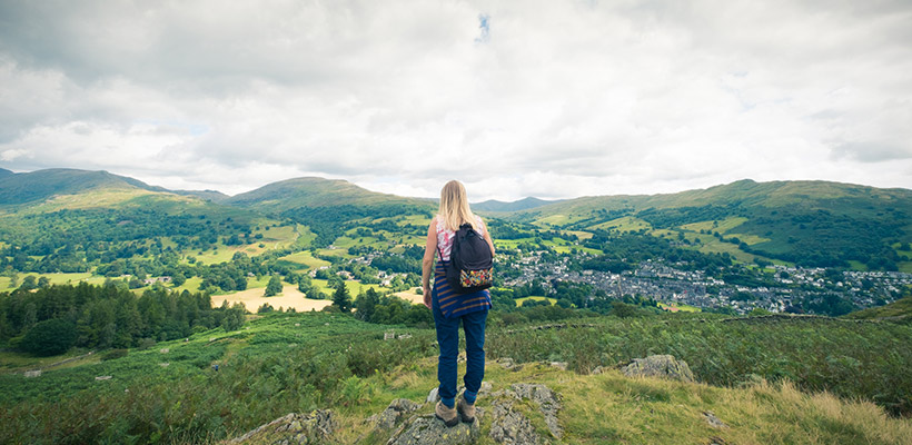Picture of someone looking out over the hills